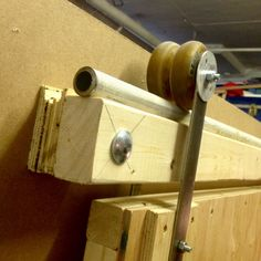 """Sliding door fittings made of two rollerblade wheels, 4 washers, two steel hinges and a round decorative cover. The rail consists of a and 1 """"steel tube. # Rollerblade wheels # Sliding door fittings diy for beginners plans tips tools Diy Sliding Barn Door, Sliding Doors, The Doors, Wood Doors, Porte Diy, Door Brackets, Door Hinges, Diy Barn Door Hardware, Window Hardware"""
