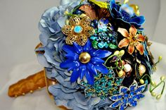 Now I'm on a brooch bouquet kick... might need to start scouring the GW Boutique for fall centerpieces!