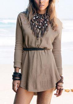 Girl in khaki cotton shift dress and tribal bib necklace