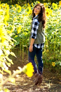 checkered shirt and military vest with ankle booties