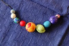 kid-made solar system necklace from #paintcutpaste