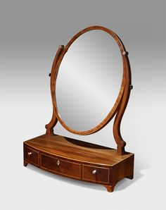 George III mahogany toilet mirror. Oval plate glass set within a crossbanded frame on shaped supports. Raised on a bow front base of three drawers with boxwood stringing and fitted with bone knobs.  circa. 1800  £680  http://www.thakehamfurniture.co.uk/antique-mirrors/dressing-and-toilet-mirror/georgian-toilet-mirror-12-25-refno-2697/