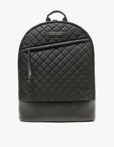 From Want Les Essentiels de la Vie, a minimalist backpack in Black. Featuring adjustable shoulder straps, leather top handle, leather base, main compartment with dual zipper closure, custom padlock and keys, interior wall pocket with snap closure, two int