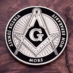 """THIS ITEM CAN ONLY BE SHIPPED WITHIN THE U.S. Whom virtue unites, death will not separate is asserted on this 1.75"""""""" shiny nickel Freemason coin. The front side features the Masonic Square and Compass"""