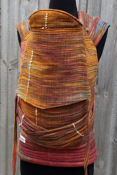 Custom toddler size ring waist meh dai with combination (hybrid) shoulder straps and petite waist and shoulder padding. This carrier was made from a gorgeous Pash Handwoven wrap 'Safe Haven'.