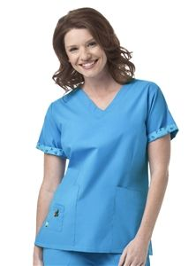 Mary Engelbreit Women's Basic V-Neck Solid Scrub Top M3003 Mary Engelbreit Women's Basic V-Neck Solid Scrub Top    • Fold over v-neck with self edged piping  • Contrasting print inside the sleeve's hem that can be worn folded up or down  • Flattering front body darts  • Side vent interiors lined with contrast print trim for added detailing  • Two large front pockets  • One small accent pocket with signature detachable ME® flower appliqué    55% Cotton 45% Polyester $21.99 #scrubs…