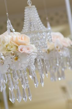 hanging-crystal-chandelier-with-roses-orchids