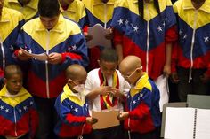 Members of the Alma Llanera Hospital Care Program's orchestra for sick children perform during their first anniversary concert in Caracas. The program is one of the most recent initiatives of Venezuela's musical education program known as El Sistema.