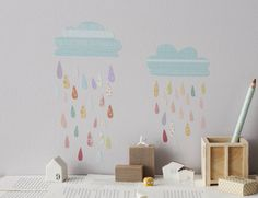 Clouds and Rain Sticker SetIf raindrops were this colourful, rainy days would be so much more fun! Beautiful sticker set in pstel colours includes two clouds and 44 patterned raindrops Clouds: 21cm x 11cm and 23cm x 12cm All our wall stickers are made of adhesive fabrics, removable and completely reusable - designed not to damage your walls Water based adhesive, non-toxic and bio degradableFabric.