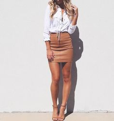 White lace up top & brown leather skirt.