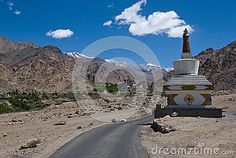Buddhist stupa along road leading to the Liker Monastery in India on sunny day.