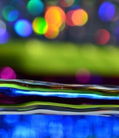 WATER FLOW ON THE COLORFUL BACKGROUND