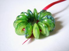 Little Jammu Set of 13 Mini Lampwork Disk Beads by helenjewellery, £12.00