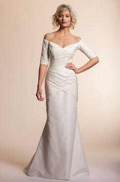 Off-shoulder sleeves on an Amy Kuschel wedding dress, 2013.
