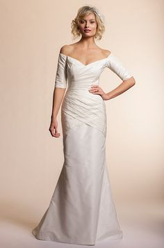 Off-shoulder sleeves on an Amy Kuschel wedding dress, 2013.