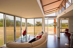 25 Shipping Container Homes. Windows that open whole walls to the outside