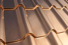 Holy mother of.... Copper tile look roof. Wow.