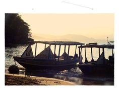 Silhouettes of boats on the shimmering water at sunset. Labadee, Nord, Haiti (travel, photography, Caribbean, sunset)
