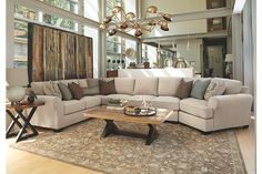 Clean Lines and Soft Chenille Outlines the Linen Sectional Sofas with Cuddlers paired with the Contrasting Light Brown and Dark Brown Cocktail Table Set