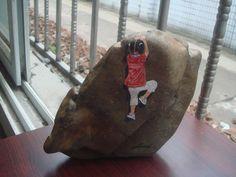 Little one climbing a rock...Brilliant!!!