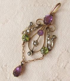 "Edwardian Suffragette pendant. The colors of the stones - green, white, and violet - stand for ""Give Women the Vote""."