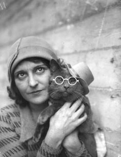 woman, cat in glasses, old photo