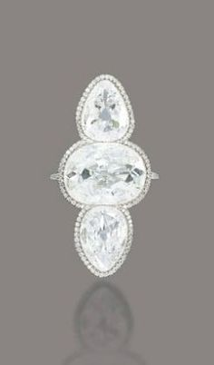 6.47 carat oval-shaped central diamond with 2.47 and 2.00 carat pear-shaped old cut diamonds set in a micro-pavé ring by JAR (1988) to be auctioned at Christie's Geneva on May 16