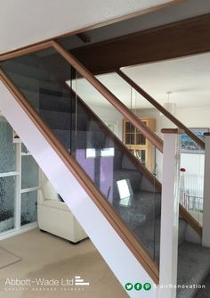 A central glass staircase like this acts as a wonderful focal point in this beautiful home. Stained Staircase, House Staircase, Modern Staircase, Glass Stairs, Glass Bannister, Stairs Balusters, Narrow Hallway Decorating, Stairway Lighting, Stairs In Living Room