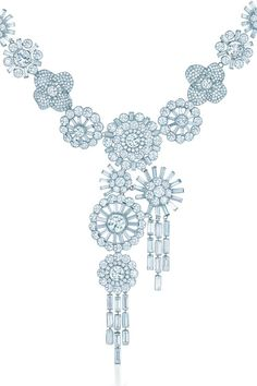 A rhapsody of stylized blossoms arrays the neckline. Corsage necklace of diamonds in platinum.