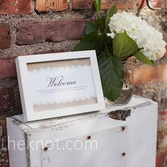 framed burlap and lace welcome sign w/ white hydrangeas in giant mason jar...all my faves!!