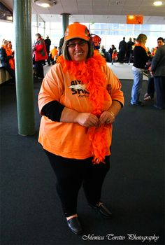 Orange Roughie !!   Proud Southland Shark supporter flaunting her orange at the Invercargill airport this morning while waiting for the arrival of the new Champions Southland Sharks. July 15, 2013.