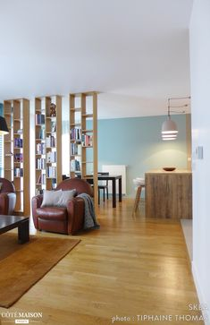 A living room separated from the dining room by a library and the kitchen by a bar. Living Room, Room, Small Space Interior Design, Living Dining Room, Separating Rooms, House Interior, Living Room Grey, Room Partition Designs, Interior Design Bedroom