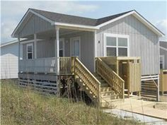 Newly remodeled oceanfront. Sits high on the dune for great ocean views! This simple beach cottage is perfect for a couple or rent all five cottages ...