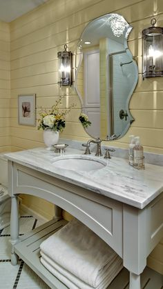 Love this Mirror !!!  Cottage Chic Bathroom  This Cottage Chic Bathroom     is a perfect fit for the  yellow  slat-boards, custom built cabinetry with Carrara marble top, rustic sconces  and beveled mirror to swoon for.