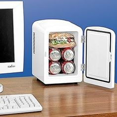 "Micro Cool Mini Fridge - this fridge at work would be epic. No more putting things in the ""community fridge."""