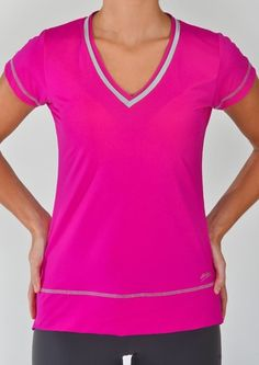 """Semi-fitted  Two tone color combination  V-neck  Cap sleeves  Detail stitching along hemline  """"StayDry"""" Wicking Microfiber Material  UV Protection UPF 50 - Blocks 98% of sun's UV rays  Anti-Bacterial Treatment        $57.00      Product Code: 21164"""