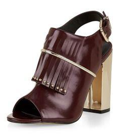 - Tassel front- Sling back fastening- Peeptoe front- Block heel