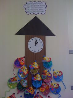 Hickory Dickory Dock! a great rhyme for learning numbers 1-5 (or 1-10) and for phonetic awareness (1 down, 2 boo, 3 wee etc.). Afterwards the kids cut out their own circles (practicing scissor skills/development of hand-eye coordination) and decorated their own mouse! Made for colorful wall display too!
