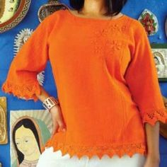 The Chapala Lace Blouse is the ultimate in cool comfort with pizzazz. It features three-quarter length sleeves and lace trim on the sleeves and hem. A floral hand-embroidered design is featured on the front left side