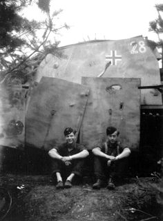 A Panzer Sd.Kfz.166 crew takes a break. Normandy. 1944. *Note the battle damage to the added armor plates.