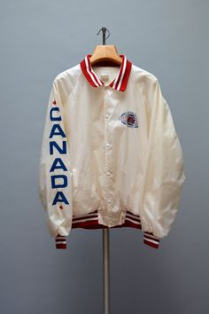 Vintage 90s souvenir off white nylon windbreaker from the 1991 World Police and Fire Games in Memphis Tennessee. This a team jacket from the British