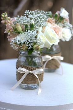 Table Decor - I do have lots of jam jars, I also have some teal vases, they aren't navy but maybe put peach flowers in them and tie on a navy colored bow...?