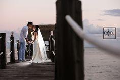 Kissing on the bridge. MTM Photography Wedding day ideas. Azul Sensatori Wedding photographer in Cancun, Playa del Carmen, Puerto Morelos, Puerto Aventuras and Tulum. 100% Satisfaction Guaranteed. guaranteed!!! www.momentsthatmatterphotography.com