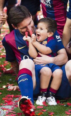 Lionel Messi & son. He's sooo cute