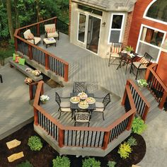 this two level deck design creates an eating area and a sitting