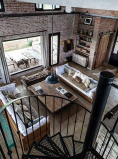 love the brick combined with the wood doors.  like the small bathroom/closet area in the corner.  the big window makes the space so bright