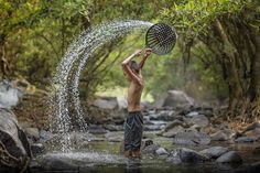 asian boy playing in the river by Venusvi on 500px