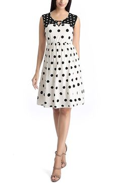 Free shipping and returns on Kimi and Kai 'Gabby' Polka Dot Maternity Dress at Nordstrom.com. Bold polka dots pattern this playful fit-and-flare dress colored in a black-and-white palette and detailed with a geometric-cutout, reverse-print yoke. The classic '50s-style silhouette and sumptuous gathers around the waist flatter your figure and keep the look timeless.
