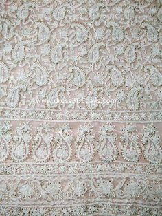 A beautiful baby pink colour unstitched dress material(two piece) with chikankari embroidery. Dupatta has border on all sides and motifs overall.  Third image is of Dupatta.  Bottom not included  Fabric: Soft Net  Length: 45 inches  Sleeves Style:Full Sleeves  Technique : Hand Embroidery  Wash Care : Hand Wash or dryclean    Since it is a hand crafted product,there can be slight variations in the embroider