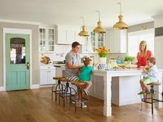 Love the huge island, the colored pantry door, and the light fixtures. House of Turquoise: Rafterhouse
